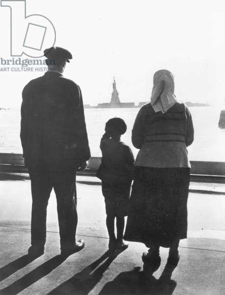 IMMIGRANTS: ELLIS ISLAND Immigrants to the United States at Ellis Island, c.1920.
