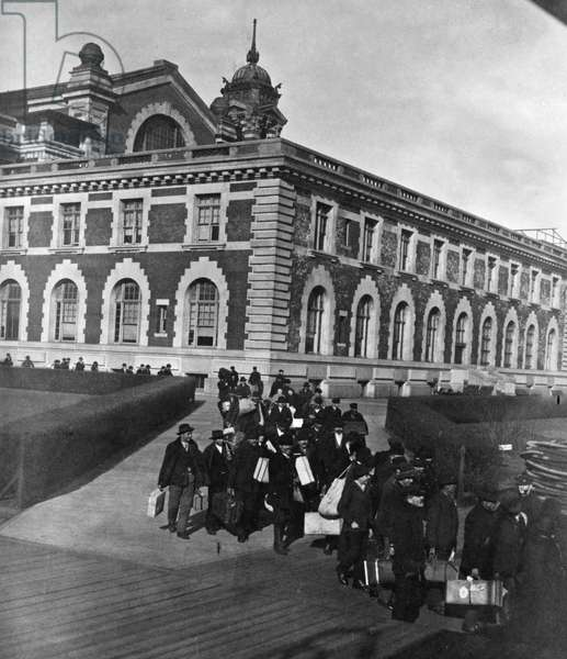 ELLIS ISLAND: IMMIGRANTS Immigrants wainting for a boat after having passed inspection at Ellis Island, the immigration station in New York Harbor. Stereograph, 1907.
