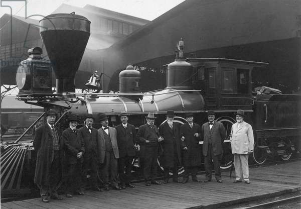 """LOCOMOTIVE/JAMES J. HILL (1838-1916). American railway promoter. Hill (sixth from left) with some of his associates in front of the """"William Crooks,"""" the first locomotive of the Great Northern Railway Company."""