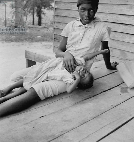 Girls from a sharecropper family on the porch of their home in North Carolina, c.1939 (b/w photo)