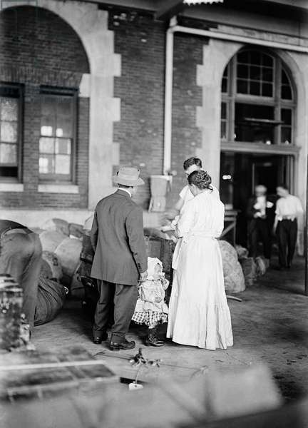 ELLIS ISLAND, 1917 A new immigrant family at Ellis Island. Photograph, March 1917.