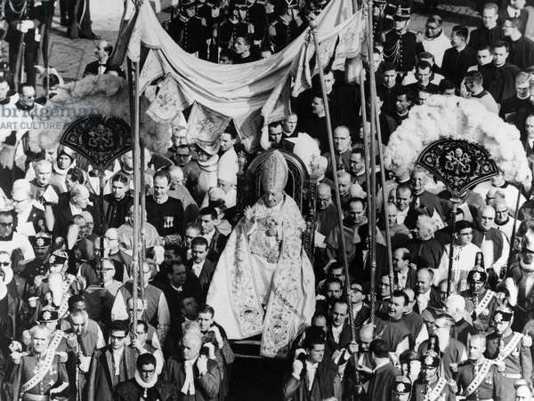 JOHN XXIII (1881-1963) Pope, 1958-1963. Blessing the crowd while being carried on his throne through St. Peter's Square in Rome to open the Second Vatican Council, 11 October 1962.
