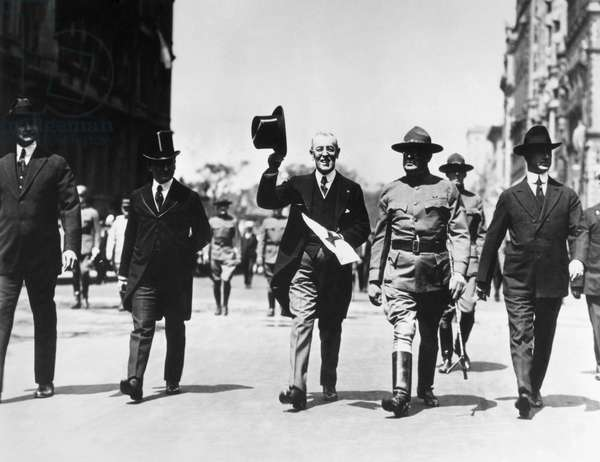 RED CROSS PARADE, c.1917 U.S. President Woodrow Wilson (center) marching in a Red Cross parade, c.1917. At left is Wilson's secretary, Joseph Patrick Tumulty and at right is General George Dyer.