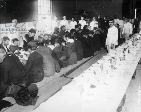 ELLIS ISLAND: DINNER, 1920s Immigrants being served 25 cent dinners at Ellis Island, the immigration station in New York Harbor, early 1920s.