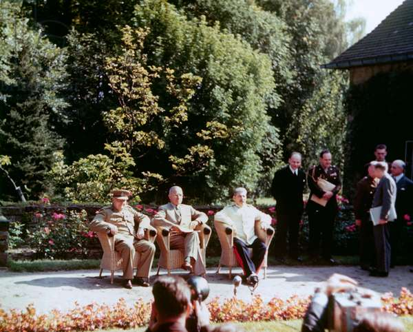 POTSDAM CONFERENCE, 1945. Allied leaders on the terrace of Castle Cecilienhof during the Potsdam Conference. From left: British Prime Minister Winston Churchill, the American President Harry S. Truman, and the Soviet head of state Joseph Stalin. Photograph, August 1945.