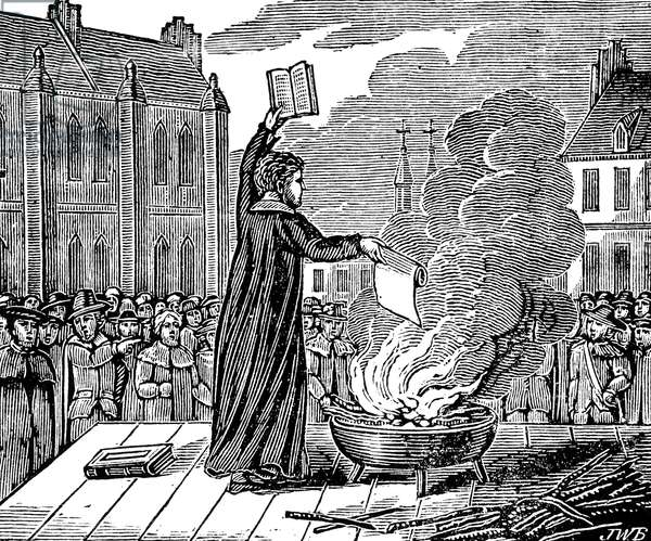 MARTIN LUTHER (1483-1546) German religious reformer. Luther burning the papal bull, or official reply, of Pope Leo X to the 'Ninety-five Theses' at Wittenberg on 10 December 1520. Wood engraving, American, early 19th century.