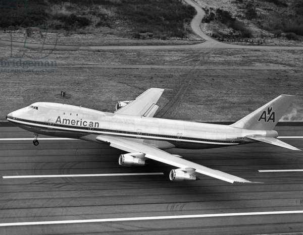 AMERICAN AIRLINES PLANE A Boeing 747 passenger plane operated by American Airlines taking off. Photograph, late 20th century.