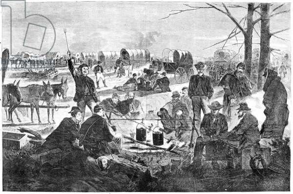 WAGON TRAIN CAMP, 1864 'Halt of a Wagon Train.' during the American Civil War. Wood engraving, American, 1864.