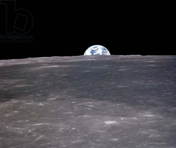 APOLLO 11: EARTHRISE, 1969 A view of the earth rising over the moon's horizon. Photographed from the Apollo 11 spacecraft, 1969.
