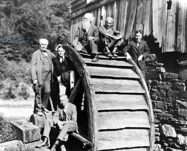 EDISON & FREINDS, 1918 Thomas Edison and friends on a camping trip at an old grist mill in West Virginia in 1918. Left to right are Edison, Harvey S, Firestone, Jr., John Burroughs, Henry Ford, Harvey S. Firestone. Seated is R.J.H. de Loach.
