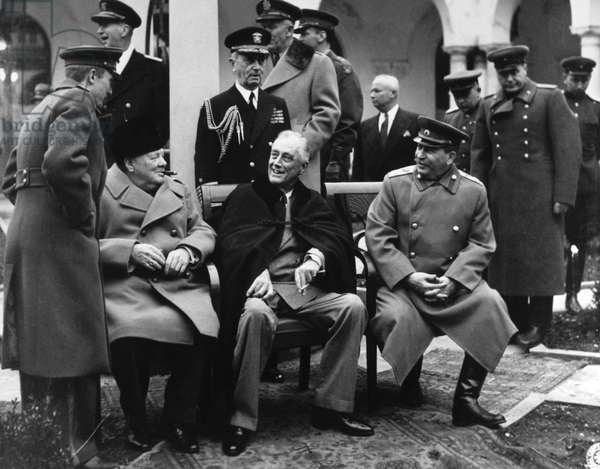 YALTA CONFERENCE, 1945 Press reception in the court of the Livadia Palace during the Yalta Conference. From left: British prime minister Winston Churchill, American president Franklin D. Roosevelt, Soviet head of state Joseph Stalin. Photograph, February 1945.