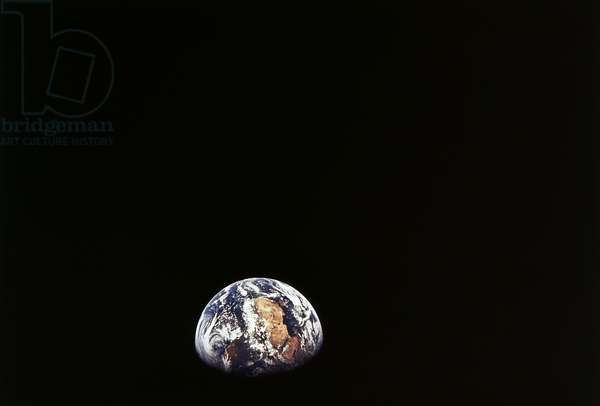 APOLLO 11: EARTH, 1969 A view of earth from the Apollo 11 spacecraft, from about 98,000 nautical miles. Photograph, 1969.
