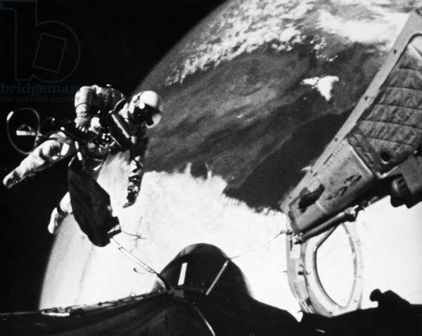 SPACE: GEMINI 4, 1965 Astronaut Edward H. White performing his spectacular space feat during the 3rd orbit of the Gemini Titan 4 flight, 3 June 1965.