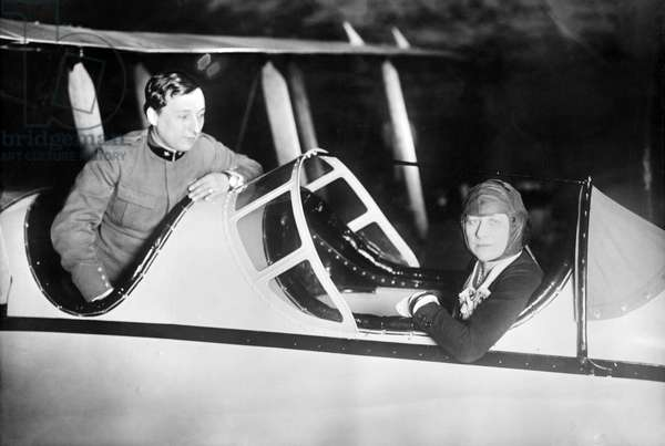 MARY GARDEN (1874-1967) Scottish-American operatic soprano. Photographed in an airplane with an Italian pilot identified as Captain U. D'Annunzio, early 20th century.