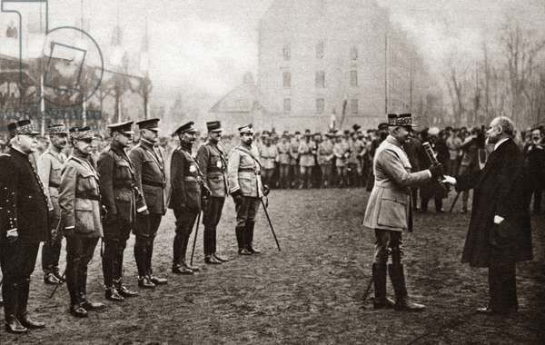 WORLD WAR I: BATON, 1918 General Henri Petain being presented with the Marshal's Baton. In attendence is Marshal Joffre, Marshal Foch, General Pershing and General Haig in Metz, France. Photograph, November 1918.