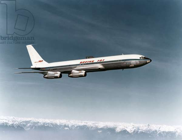 BOEING 707 AIRPLANE A Boeing 707 passenger plane in flight. Photograph, mid or late 20th century.