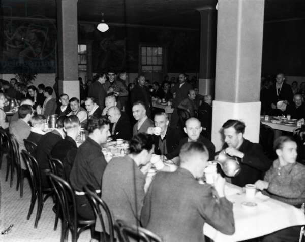 ELLIS ISLAND, 1939 German seamen, rescued from the destroyed German ship S.S. Columbus, having a meal in the dining hall at Ellis Island. Photograph, 1939.