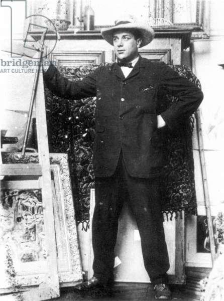 George Braque posing in Pablo Picasso's studio at Paris, c. 1910 (b/w photo)