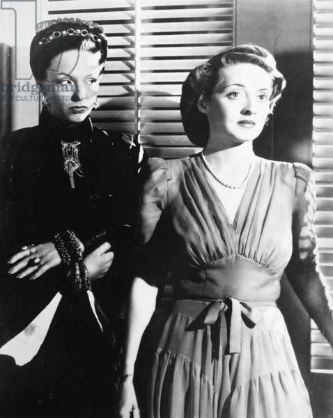 BETTE DAVIS (1908-1989) Bette Davis and Gale Sondergaard in 'The Letter,' 1940.