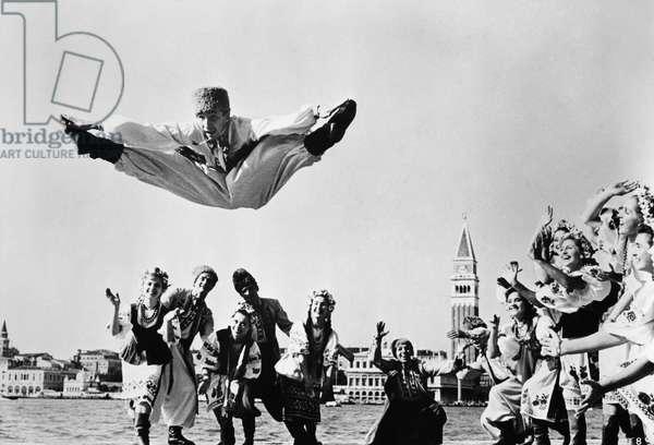 UKRAINIAN FOLK DANCE, c.1970 Folk dancer Ravil Khusayinov (center) of the Moiseyev Dance Company, in a production of the Ukranian suite, 'Gopak,' c.1970.