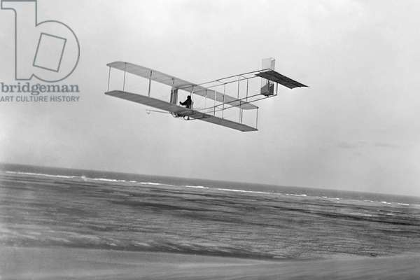 WRIGHT BROTHERS GLIDER Rear view of Wright glider in flight at Kitty Hawk, North Carolina, 1911.