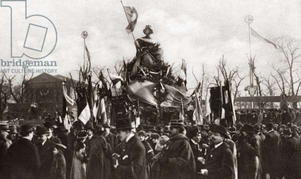 WORLD WAR I: MONUMENT The Strasbourg Monument which for decades had been veiled in black over the loss of Alsace-Lorraine to Germany is decked with flowers and flags to celebrate the signing of the Armistice in Paris, France. Photograph, 1918.