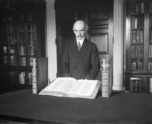 HERBERT PUTNAM (1861-1955) American librarian. Exhibiting a Gutenberg Bible in his capacity as the eighth Librarian of Congress. Photograph by Harris & Ewing, 15 December 1930.