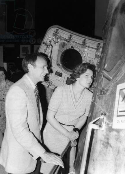 ASTRONAUTS, 1977 Soviet cosmonaut Valentina Tereshkova Nikolayeva touring the Johnson Space Center with American astronaut Alan Bean. Photograph, 1977.