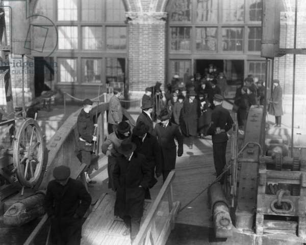 DEPORTATION, 1920 Suspected communists and other radical foreign citizens boarding a steamer to await deportation proceedings at Ellis Island. Photograph, 1920.