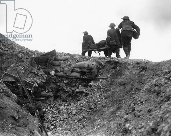 WWI: SOMME, 1916 Soldiers carrying a wounded man on a stretcher during The Battle of Thiepval on the Somme, France. Photograph by Ernest Brooks, September 1916.