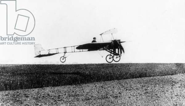 LOUIS BLERIOT (1872-1936) French engineer and pioneer aviator. Bleriot in his monoplane in flight over France, May 1909.
