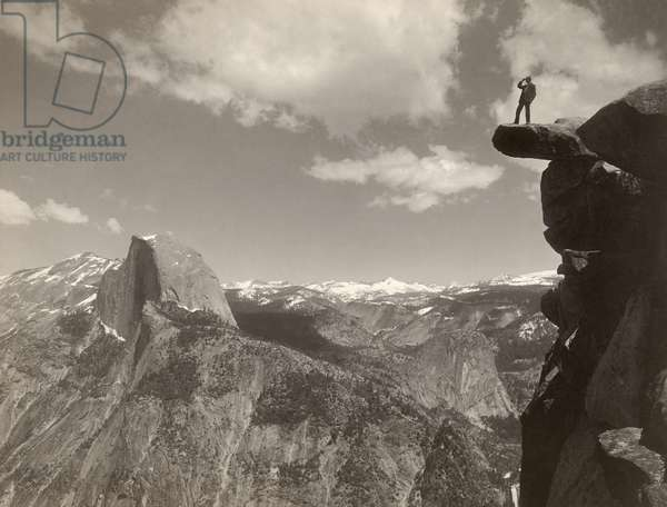 YOSEMITE VALLEY, c.1901 A man standing on a overhanging rock facing Half Dome at Glacier Point in Yosemite National Park, California. Stereograph, c.1901.