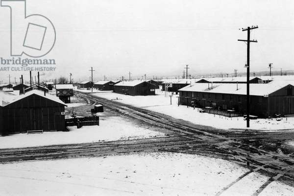 JAPANESE INTERNMENT, 1943 Winter storm at the Manzanar Relocation Center for Japanese Americans at Owens Valley, California. Photograph by Ansel Adams, 1943.