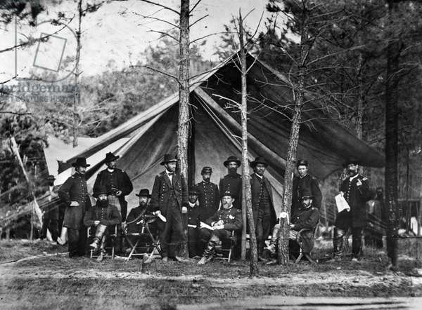 COLD HARBOR, 1864 General Ulysses S. Grant, standing against a tree, and his staff at Cold Harbor, Virginia, May 1864, during the American Civil War.