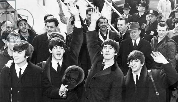 THE BEATLES, 1964 The Beatles arriving at John F. Kennedy Airport in New York City. Photograph, 7 February 1964.
