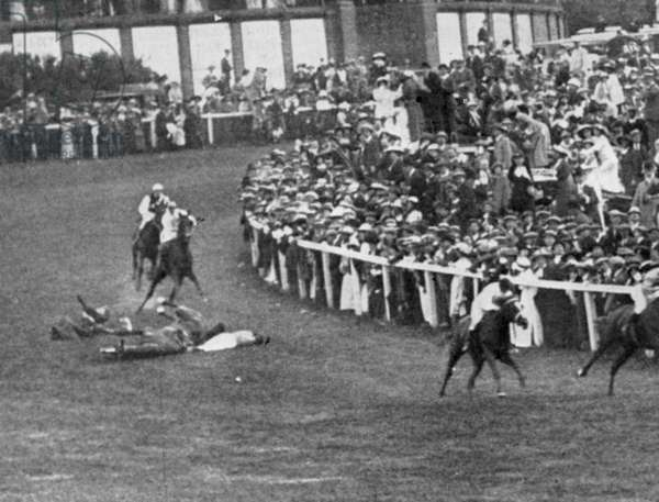 WOMEN'S RIGHTS: DERBY 1913 The scene at the Derby moments after militant suffragette Emily Wilding Davison threw herself before the King's horse, 4 June 1913; Miss Davison, who later died of her injuries, and jockey Herbert Jones, who sustained only a broken rib, lie on either side of the fallen horse as the other horses continue around