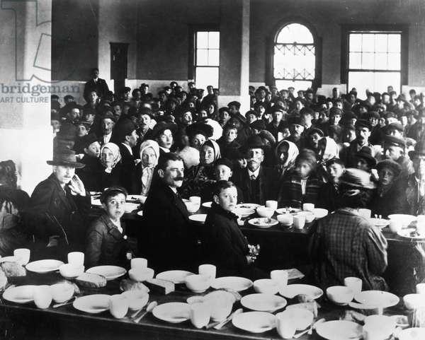 IMMIGRANTS: ELLIS ISLAND The dining hall at Ellis Isalnd, c.1900.