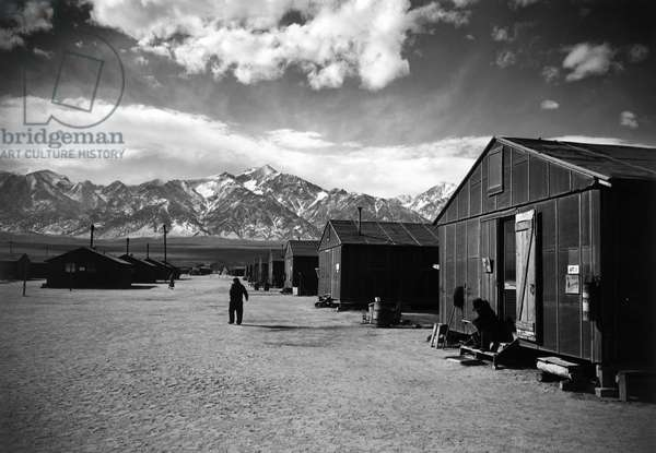JAPANESE INTERNMENT, 1943 Street and barracks at the Manzanar Relocation Center for Japanese-Americans at Owens Valley, California. Photograph by Ansel Adams, 1943.