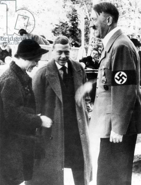EDWARD VIII (1894-1972) King of Great Britain, 1936. Photographed with his wife, the Duchess of Windsor and Adolf Hitler in Germany, October 1937.