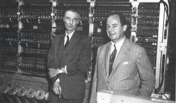 JOHN von NEUMANN (1903-1957). The American (Hungarian-born) mathematician, right, with J. Robert Oppenheimer at the 1952 dedication ceremony for the computer built at the Institute for Advanced Study, Princeton, New Jersey, of which Neumann was director.