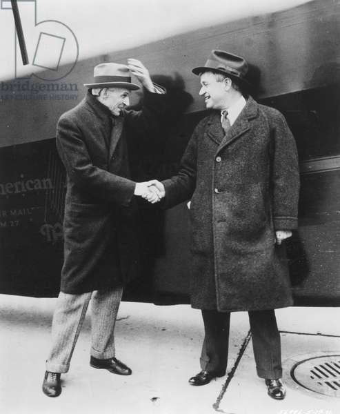 HENRY FORD (left) greeting Will Rogers in Detroit.