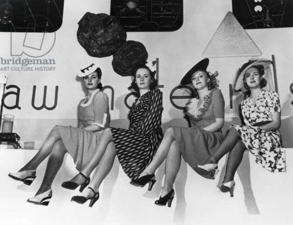 NEW YORK WORLD'S FAIR, 1939 Women modeling the first nylon stockings at the at the New York World's Fair in Flushing Meadows, Queens, New York. Photograph, 1939.