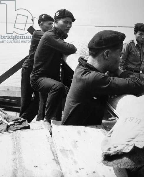 VIETNAM WAR: VIETNAM NAVY Vietnamese junk fleet sailors wearing black pajama-type uniforms, June 1964.