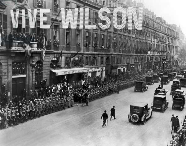 WOODROW WILSON IN PARIS Paris greeting Woodrow Wilson during the Paris Peace Conference when passing Maxim's Restaurant in the Rue Royale. Photograph, 1919.