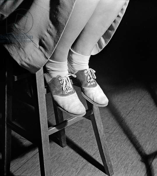 SADDLE SHOES, 1943 A student at Woodrow Wilson High School wearing saddle shoes. Photograph by Esther Bubley, 1943.