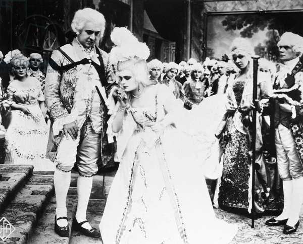 FILM: MADAME DU BARRY, 1919 Pola Negri, in the title role, kisses the hand of King Louis XV of France (Emil Jannings) in a scene from the German film 'Madame Du Barry' directed by Ernst Lubitsch, 1919.