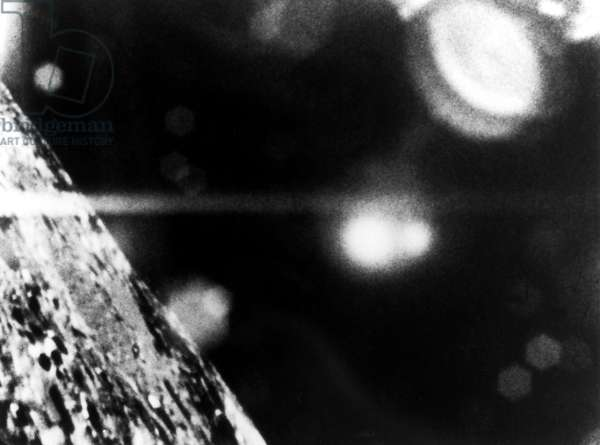 APOLLO 11: WINDOW VIEW View out of the window of Apollo 11, with glares and reflections of cabin lights, July 1969.