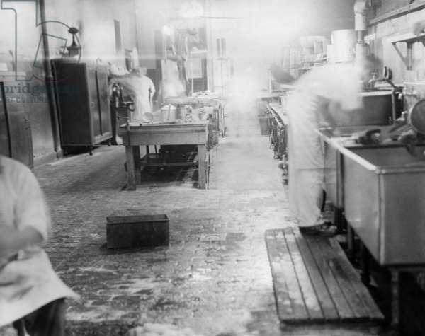 ELLIS ISLAND, c.1943 Detained 'enemy aliens' working in the kitchen at Ellis Island during World War II. Photograph, c.1943.