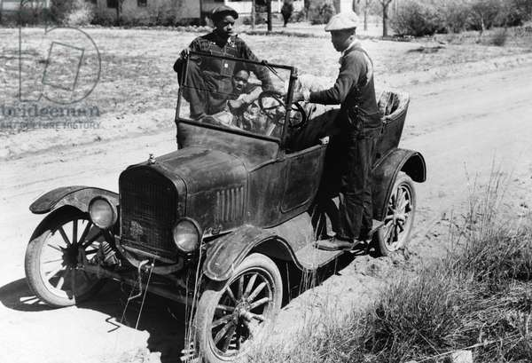 MODEL T FORD, 1941 African American young men and their Model T Ford near Pacolet, South Carolina. Photograph by Jack Delano, March 1941.