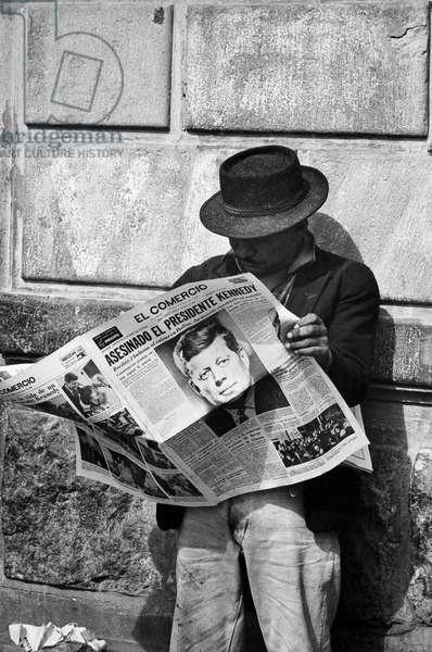 KENNEDY ASSASSINATION, 1963 An Ecuadoran man reads about the assassination of John F. Kennedy in 'El Comercio' newspaper, 23 November 1963.
